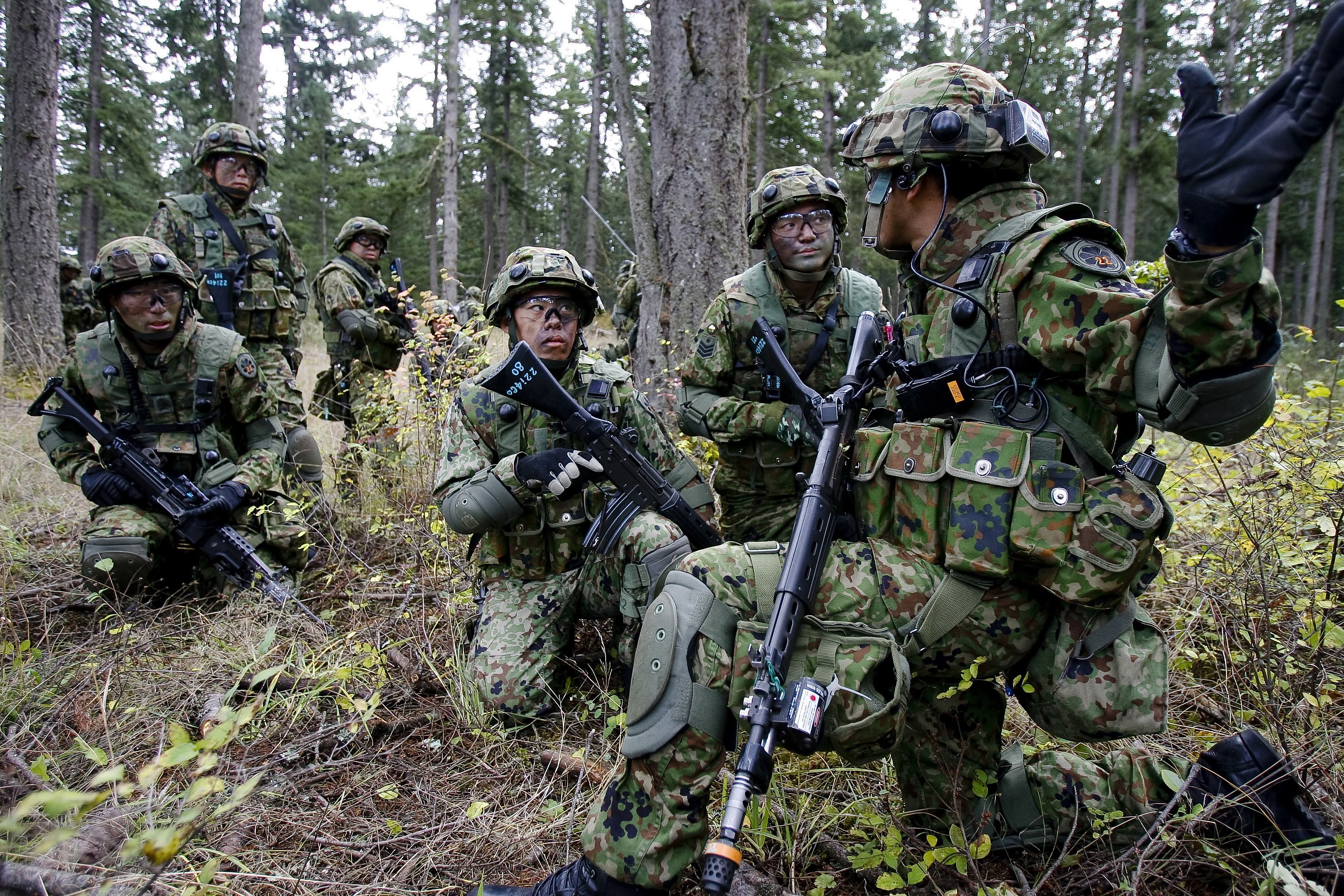 Japanese soldiers from the 22nd Infantry Regiment of the Japan Ground Self-Defense Force train in urban assault with American Soldiers from 1st Battalion, 17th Infantry Regiment, 5th Brigade Oct. 17, 2008 during a bilateral exercise at Fort Lewis' Leschi Town. (via Wikipedia)